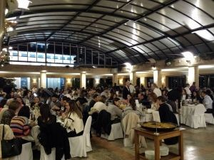 The group of 260 people enjoying dinner after cooking the paellas of the paellas contest of this event in Valencia