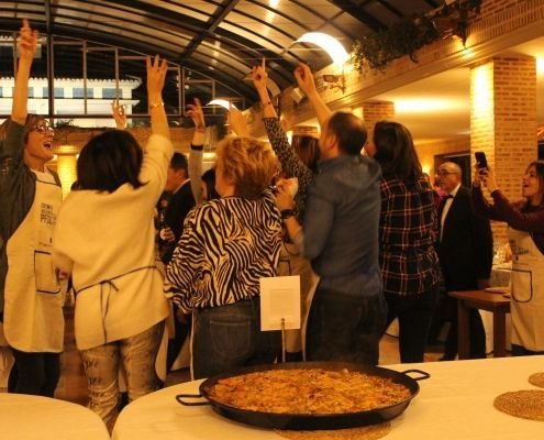 The winners celebrate the victory with their winning paella the best of this paella contest during the event in Valencia.
